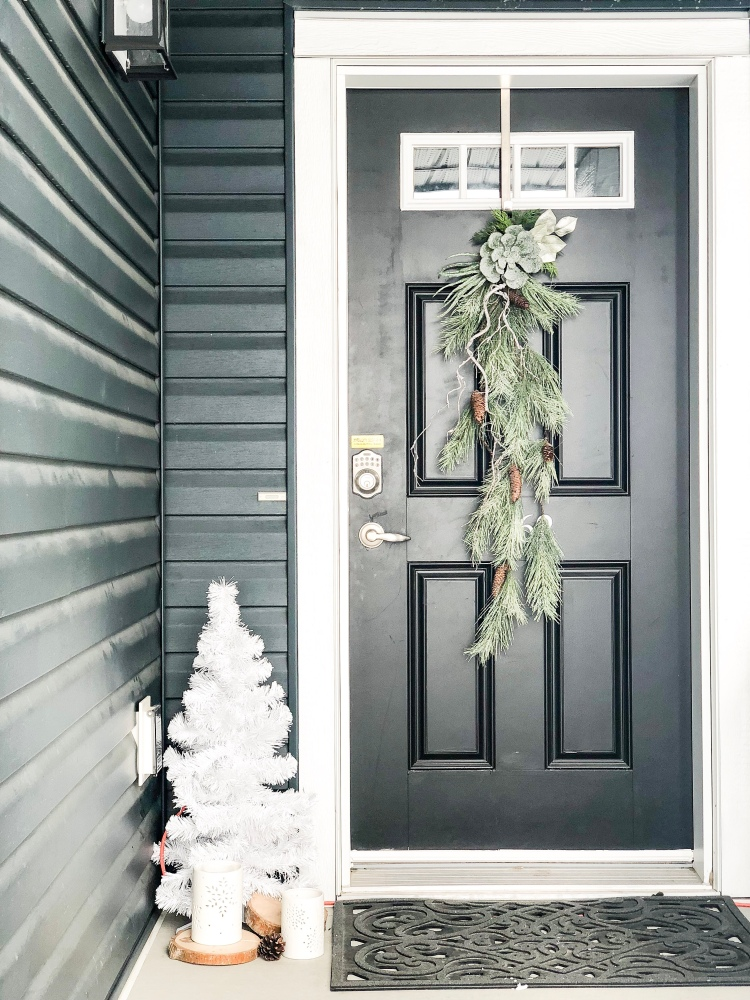 i like do my front door decor more winterish than christmas because alberta has long winters and i want to keep my decor out until spring